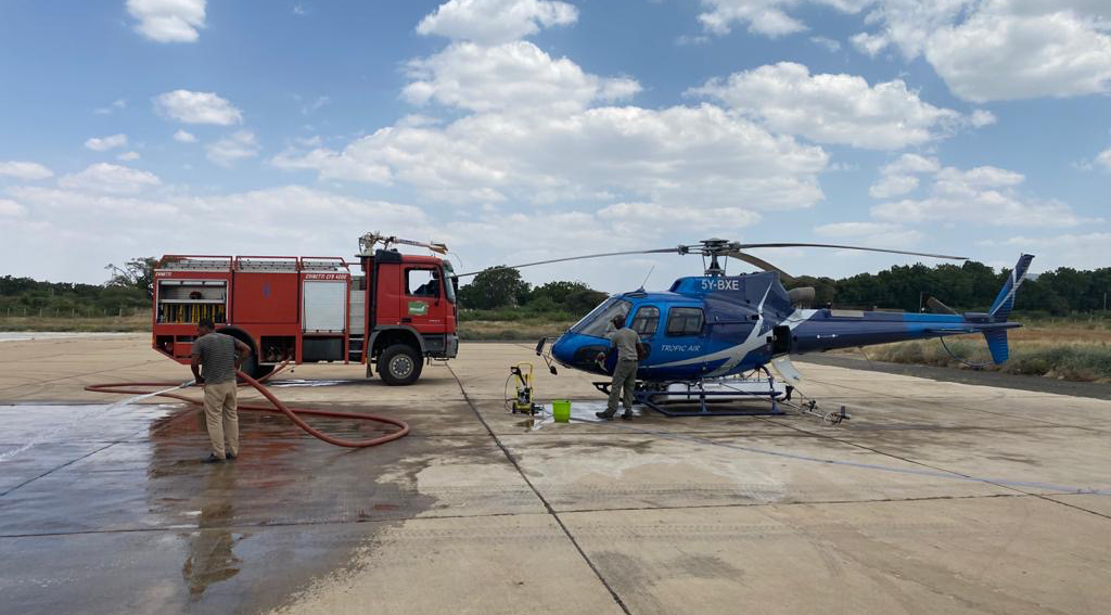 Cleaning the H125 after flight, Ethiopia, Dira Dawa